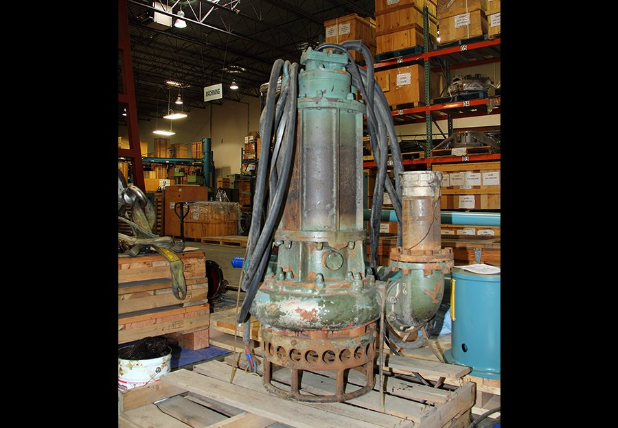 An old and still working Hevvy Pumps slurry pump being shipped.